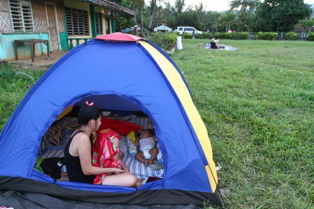 Some residents in Barangay Serran, Wao, Lanao del Sur spend the night at the school ground for safety reasons following the series of aftershocks on Wednesday. © Keith Bacongco