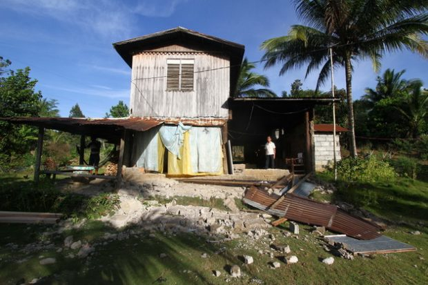 A wall of the house owned by Estandarte family in Barangay Makaopao, Kalilangan, Bukidnon collapsed due to Magnitude 6 eathquake Wednesday morning. © Keith Bacongco