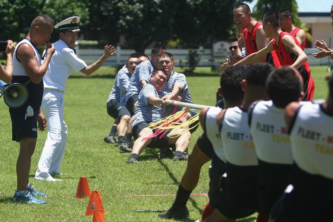 Chinese and Filipino Navy sailors give out their best in a different battle during a friendly game of 'tug of war' at the Philippine Navy camp during a goodwill visit of the Chinese Navy in Davao City on May 1, 2017.