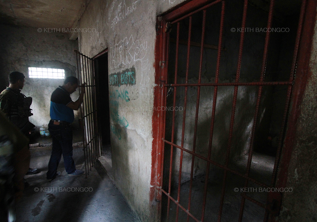 Jail warden Mohammad Yusoph shows what's inside the MILF detention facility. (Keith Bacongco)